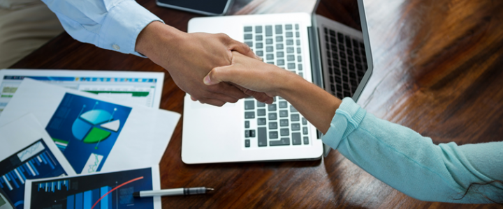CRM for professional services shaking hands at meeting